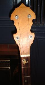 Close-up of the peghead and top frets