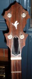 close-up of the mother-of-pearl heron inlay on the peghead of the banjo