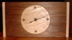 a walnut and hickory clock