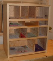 A plywood organizer for holding various forms and labels.